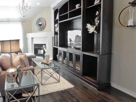 transitional neutral living room  dark wood floor