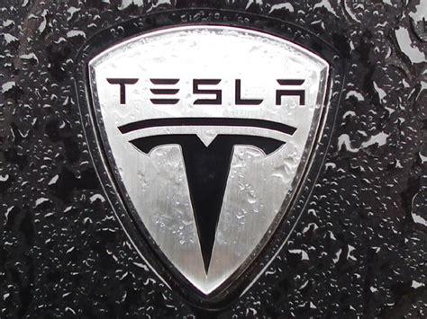 tesla motors emblem tesla logo wallpaper wallpaper ideas