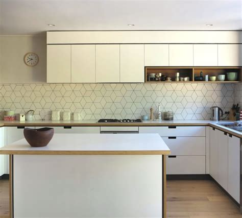splashback ideas for kitchens geometric tiled splashback white kitchen timber details