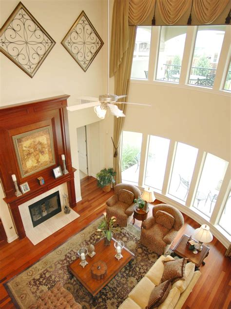 2 story living room traditional white living room with two story ceiling the second floor provides a commanding view