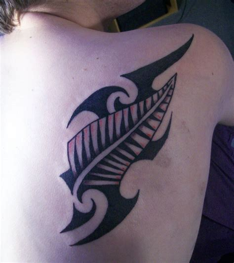 maori tribal design and silver fern tattoo