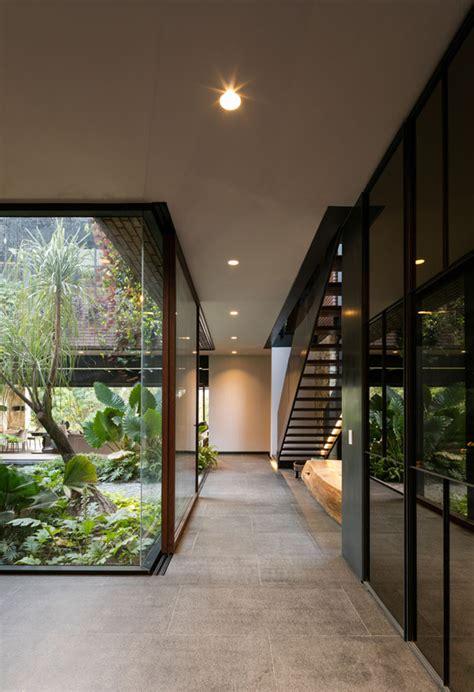 indoor glass hallway  nature view