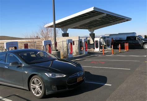 image solar panels  supercharger  barstow ca  tesla model  road trip photo david