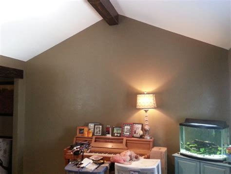 what to do with blank wall with cathedral ceiling in my living room