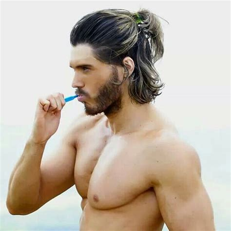ponytail hairstyles for guys the new man bun the half ponytail for men