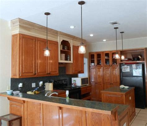 extending kitchen cabinets to ceiling extend kitchen cabinets to the ceiling for the home