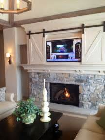 putting doors to use 25 best ideas about tv above fireplace on tv