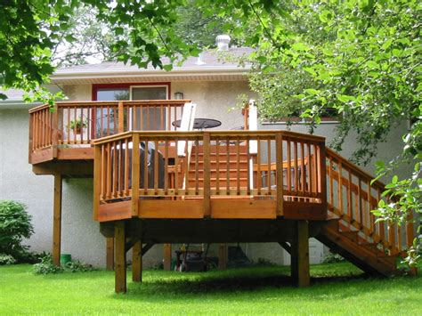 exterior design and decks exterior exterior design featuring wooden deck elevated