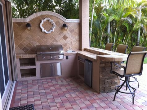 custom backyard bbq grills custom outdoor kitchen built in bbq grill island with backsplash and dry stack ledge