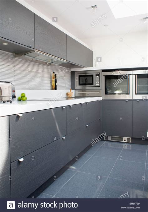 kitchen with grey floor grey ceramic floor tiles in modern white kitchen with