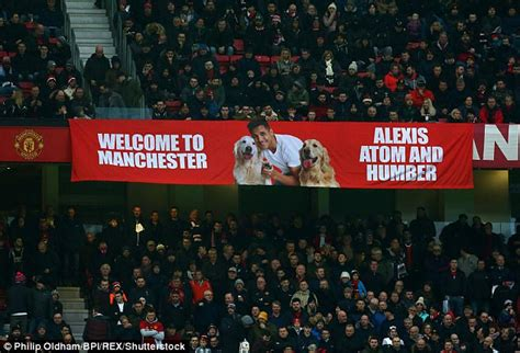 alexis sanchez dogs banner manchester united fans unveil banner to welcome alexis