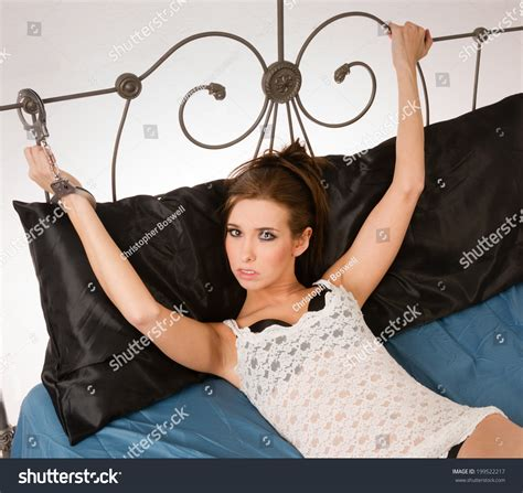 How To Use Handcuffs In Bed by Pretty Angry Restrained Handcuffs Wrought Iron Bed Frame Stock Photo 199522217