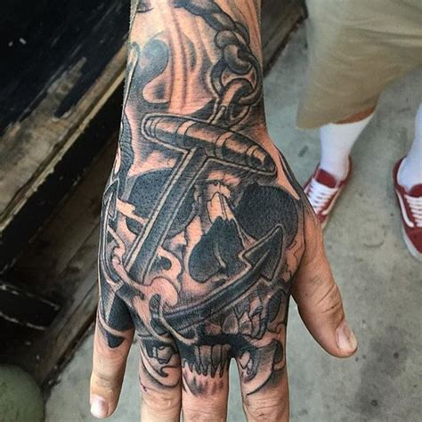 hand tattoo jobstopper skull and anchor hand tattoo