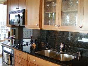 black backsplash kitchen best 25 black granite kitchen ideas on