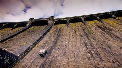 old land climbing a 200ft high dam in a 64 year old land rover so