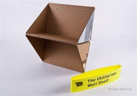 Rak Buku Gantung Berbahan Kardus the utilitarian wall shelf en themag