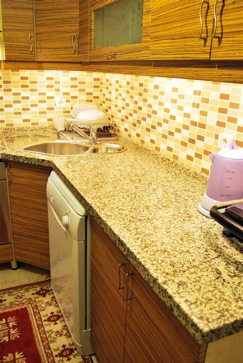 pros cons quartz marble granite countertops rino