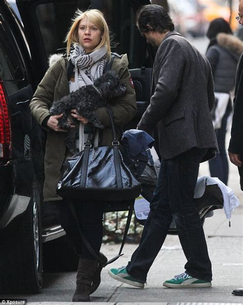 claire danes spouse claire danes clutches on to her dog while husband hugh