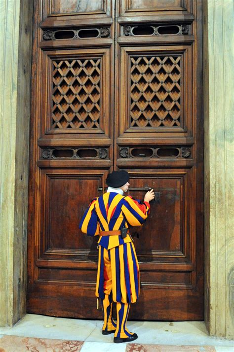 The Door by File A Swiss Guard Unlocks The Door Outside Of The Sistine