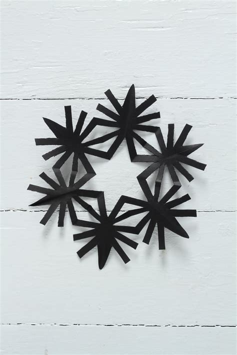 A Snowflake Out Of Paper - 5 ways to celebrate make a cut out snowflake day tip