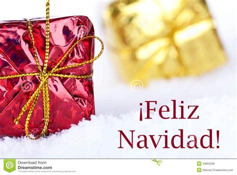 feliz navidad   snow  gifts stock photo image
