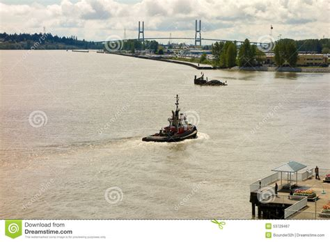 boat shipping vancouver a tug boat cruising along vancouver s waterfront editorial