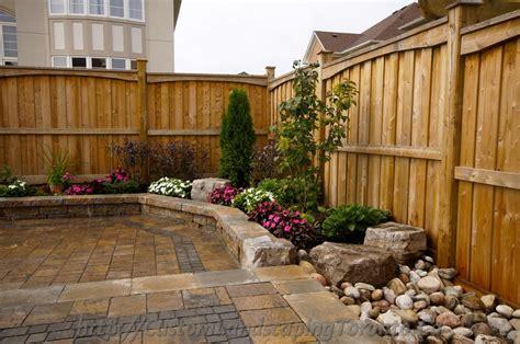 landscaping toronto backyard interlocking project with flower beds toronto