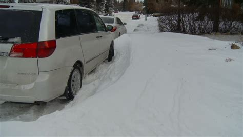Minivan In Snow by Winter