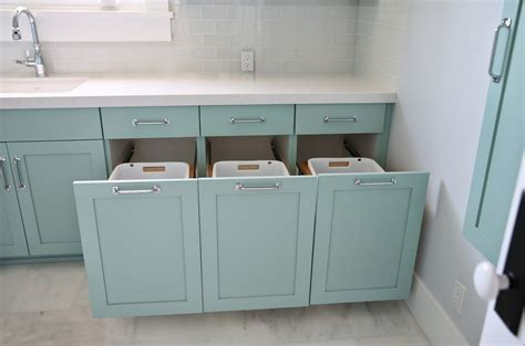 linen cabinet with tilt out her laundry sorter cabinet bar cabinet