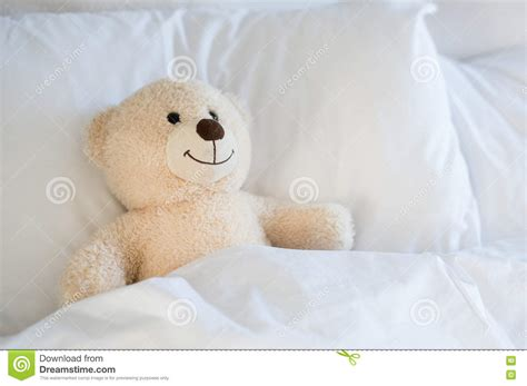 teddy bear bed teddy bear on bed stock photo image of pillow sleeping