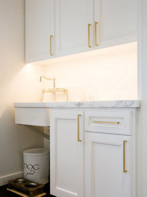 White Cabinets With Long Brass Pulls Transitional White Cabinets For Laundry Room