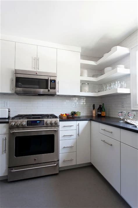 floating cabinets kitchen floating shelves black granite countertops modern