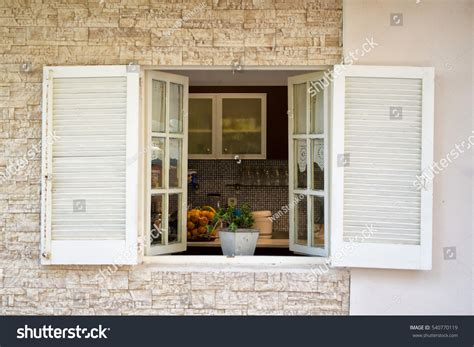 view into kitchen through white wooden stock photo