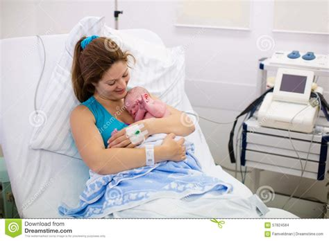 children in delivery room giving birth to a baby stock photo image 57824584