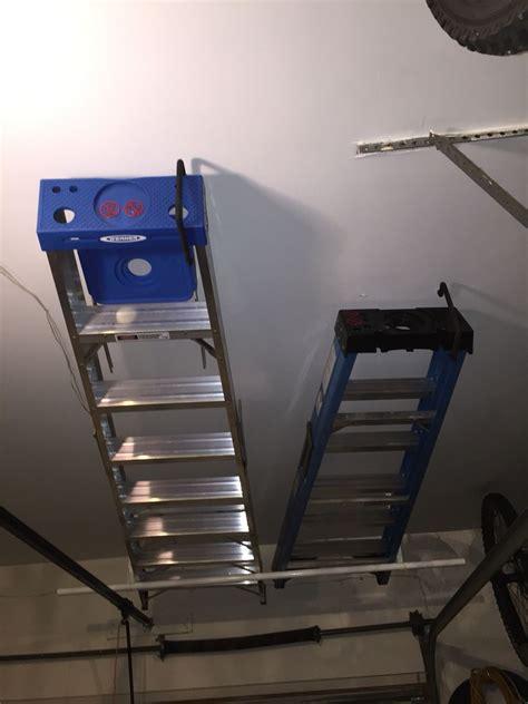 easy ladder storage   garage door   clothes