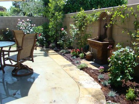 tuscan inspired backyards tuscan patio with water feature ideas courtyard