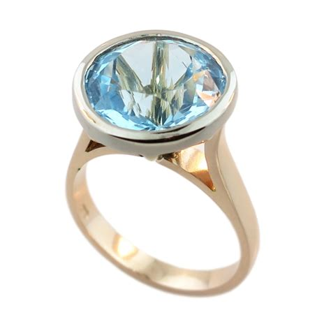 9ct yellow white gold blue topaz ring cameron