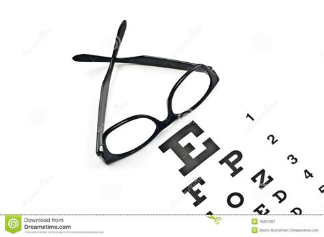 reading glasses with eye chart royalty free stock