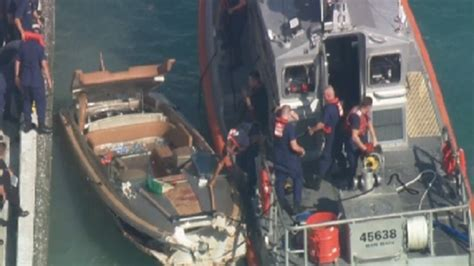 boating accident dubay boat crashes into seawall at coast guard station in miami