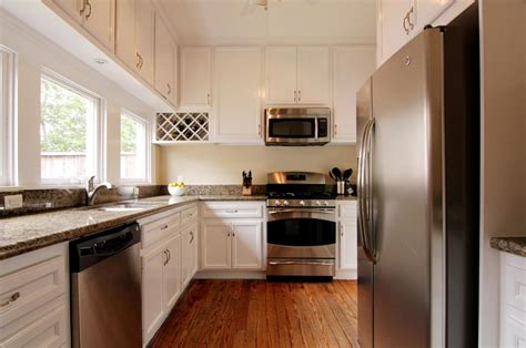 White Kitchens With Stainless Steel Appliances | classic and antique white kitchen cabinets with stainless steel appliances and brown wooden