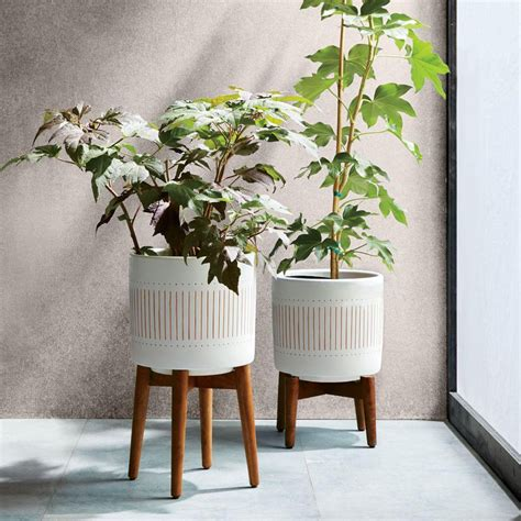 mid century planters mid century turned wood leg planters patterned west elm uk