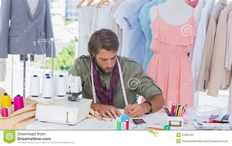 designer pics fashion designer drawing on a desk stock photo image 31800120
