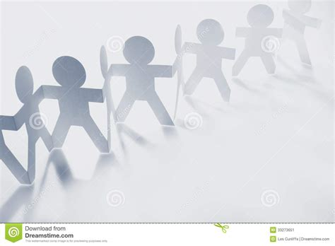 How To Make Paper Dolls Holding - team stock image image 33273651