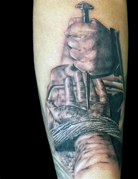 jesus nail tattoo dramatic realism style colored forearm tattoo of hand