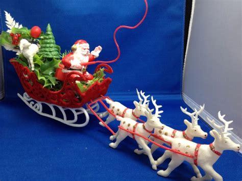 vintage plastic santa claus flocked sleigh reindeer lamb