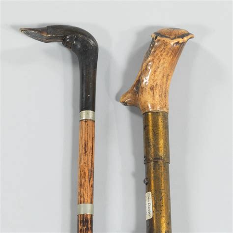 antique walking stick or that has a large an antique walking stick dagger and a dagger 09 08