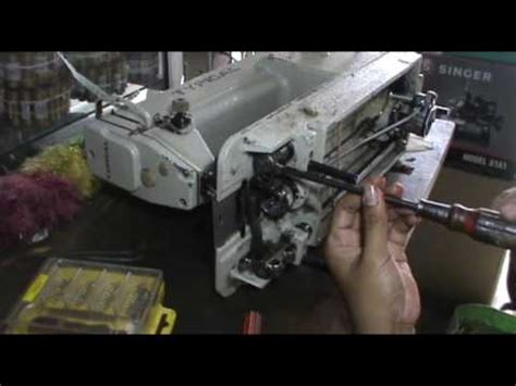 Mesin Jahit Typical repair a typical industrial sewing machine got stuck