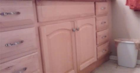 can you re paint stain prefinished cabinets without