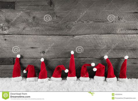 wooden christmas background with red santa hats for a