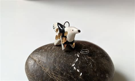 ceramic  gold anteater charm kness